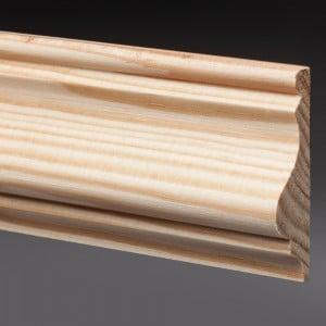 Photographie packshot d'une moulure en bois avec un fond gris dégradé