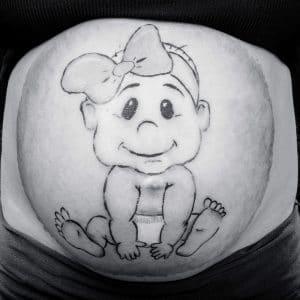 Photographie d'un ventre avec du belly painting